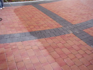 A paver installation at a new high end office building required durable protection to maintain the image of the property