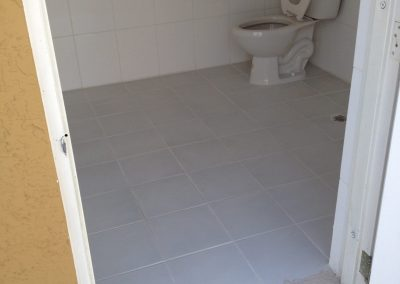sealing grout commercial restroom