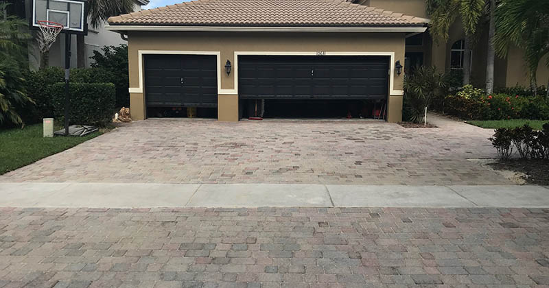 This residential location in Lake Worth had pavers that had faded badly over the years.