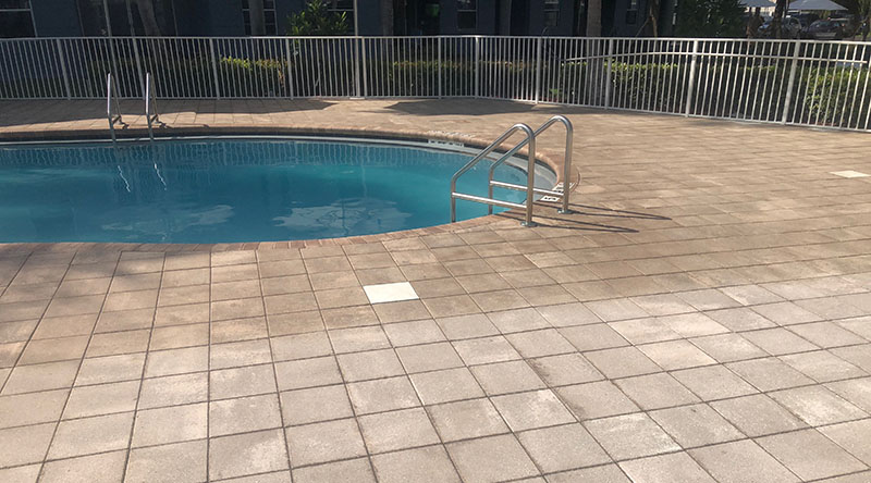 SEALING PAVERS – COMMERCIAL POOL DECK PAVERS